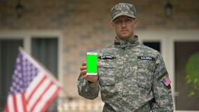Soldier showing phone with green screen, veterans psychological support online. Stock footage stock video footage