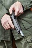 Soldier shutter cocking pistol gun Royalty Free Stock Photos