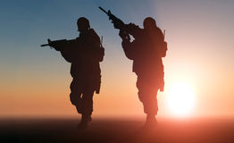Soldier. Silhouette of a soldier against the sun Stock Image