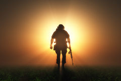 Soldier. Silhouette of a soldier in the fog Stock Photos