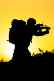 Soldier silhouette. On the orange background Royalty Free Stock Image