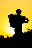Soldier silhouette. On the orange background Stock Photography