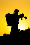 Soldier silhouette. On the orange background Royalty Free Stock Photography