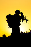 Soldier silhouette. On the orange background Royalty Free Stock Photos