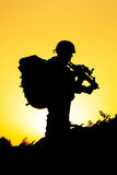 Soldier silhouette. On the orange background Stock Image