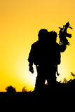 Soldier silhouette. On the orange background Stock Images