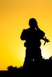 Soldier silhouette. On the orange background stock photos