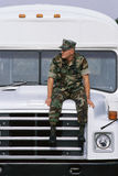 Soldier sitting on military bus Stock Photos