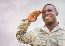 Soldier smiling and saluting against white map with interface Stock Photo