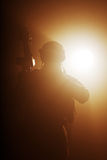 Soldier in the smoke Stock Images