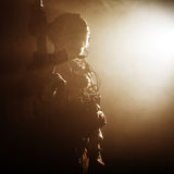 Soldier in the smoke. Special forces soldier with rifle in the smoke Royalty Free Stock Photo