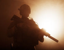 Soldier in the smoke. Special forces soldier with rifle in the smoke Royalty Free Stock Image