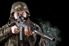 Soldier with the smoking gun. In studio. Isolated royalty free stock images