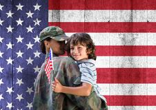 Soldier and son in front of usa flag. Digital composite of soldier and son in front of usa flag stock images