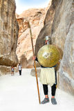 Soldier with spear guards roadway in Petra Stock Photos