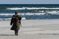 SOLDIER FROM SECOND WORLD WAR. Soldier of the 1st Army of the Polish Army on the sea beach Royalty Free Stock Photography