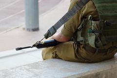 Soldier on Stadiums Bleachers on Guard.  royalty free stock photography