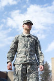 Soldier stand over blue sky royalty free stock photo
