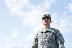 Soldier stand over blue sky Stock Photo