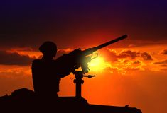 Soldier on Standby at Armed Tank. During Sunset royalty free stock photography