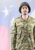 Soldier standing on american flag background Royalty Free Stock Photography