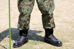 Soldier standing  with  boots. Soldier standing with lightweight military boots Stock Image