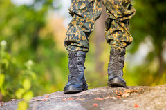 Soldier standing on stone Royalty Free Stock Photo
