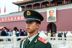 Soldier stands guard in front of Forbidden City in Stock Image