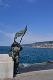 Soldier Statue, Trieste, Italy. Trieste, Italy: Bronze of Bersagliere soldier statue with flag in Trieste, near Unita d'Italia Square Royalty Free Stock Photography