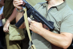Soldier with a submachine gun in his hand in training camp for n Royalty Free Stock Photos