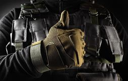 Soldier in tactical gloves showing like front view closeup