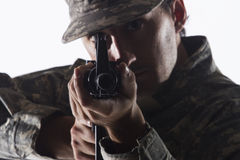 Soldier taking aim with assault rifle, horizontal Royalty Free Stock Images