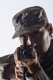 Soldier taking aim with assault rifle, vertical Stock Images