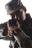 Soldier taking aim with assault rifle, vertical Royalty Free Stock Photography