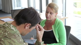 Soldier Talking To Female Counsellor In Office. Soldier discussing problems with counsellor who listens and takes notes. Shot on Canon 5D MkII at 25fps stock footage