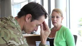 Soldier Talking To Female Counsellor In Office. Soldier discussing problems with counsellor who listens and takes notes. Shot on Canon 5D MkII at 25fps stock video footage