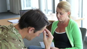 Soldier Talking To Female Counsellor In Office. Soldier discussing problems with counsellor who listens and takes notes. Shot on Canon 5D MkII at 25fps stock video