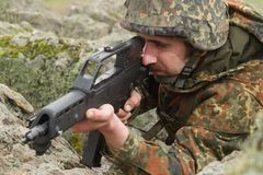 Soldier targeting from covered position Royalty Free Stock Image