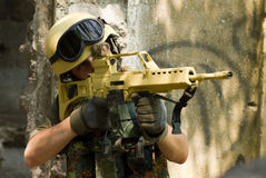 Soldier targeting with a rifle. Eagle-eye shooter is on his assignment Stock Images