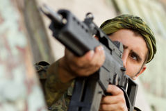 Soldier targeting with a rifle. Soldier with automatic G36 rifle aiming his target Stock Image