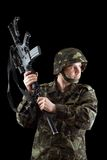 Soldier threatening with a rifle Stock Photography