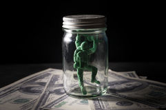 Soldier toy in bottle on money. Royalty Free Stock Photo
