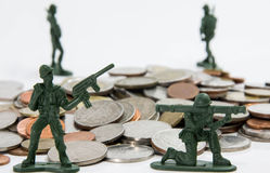 Soldier toy with coins ( shallow depth of field) Royalty Free Stock Image