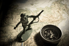 Soldier toys with compass on map Stock Photography