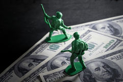 Soldier toys on money. Stock Image