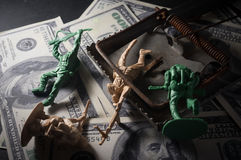 Soldier toys with mouse trap on money. stock images