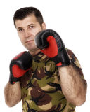 Soldier training with boxing gloves Stock Image