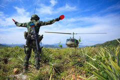 Soldier in tropical forest. Soldier in uniform with gun royalty free stock photography