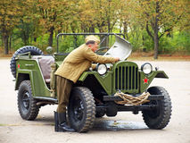 Soldier try to repair soviet military automobile Gaz 67. Stock Images
