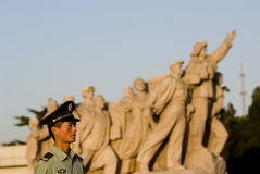 A soldier under the revolutionary sculpture, beijing, china Royalty Free Stock Photo